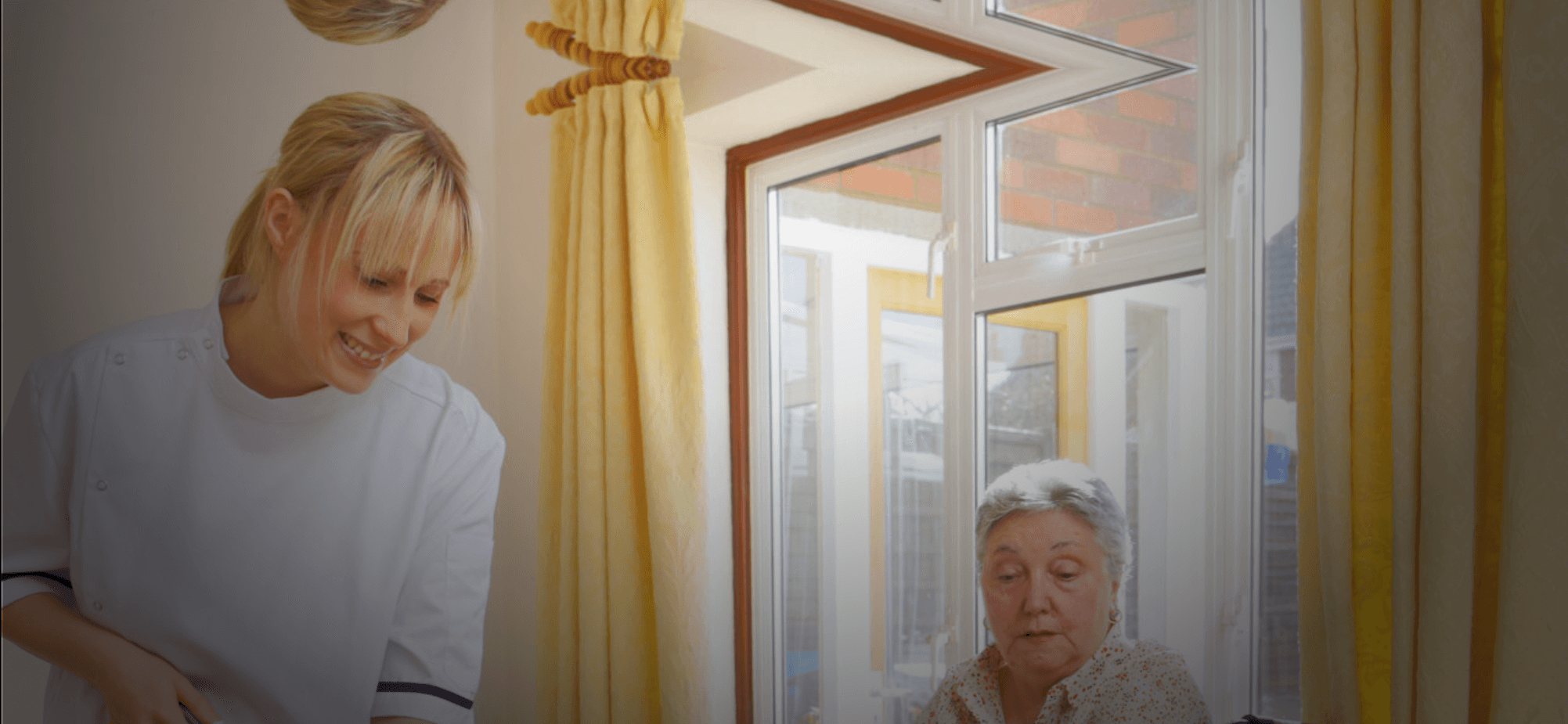 a nurse cleaning and an old woman