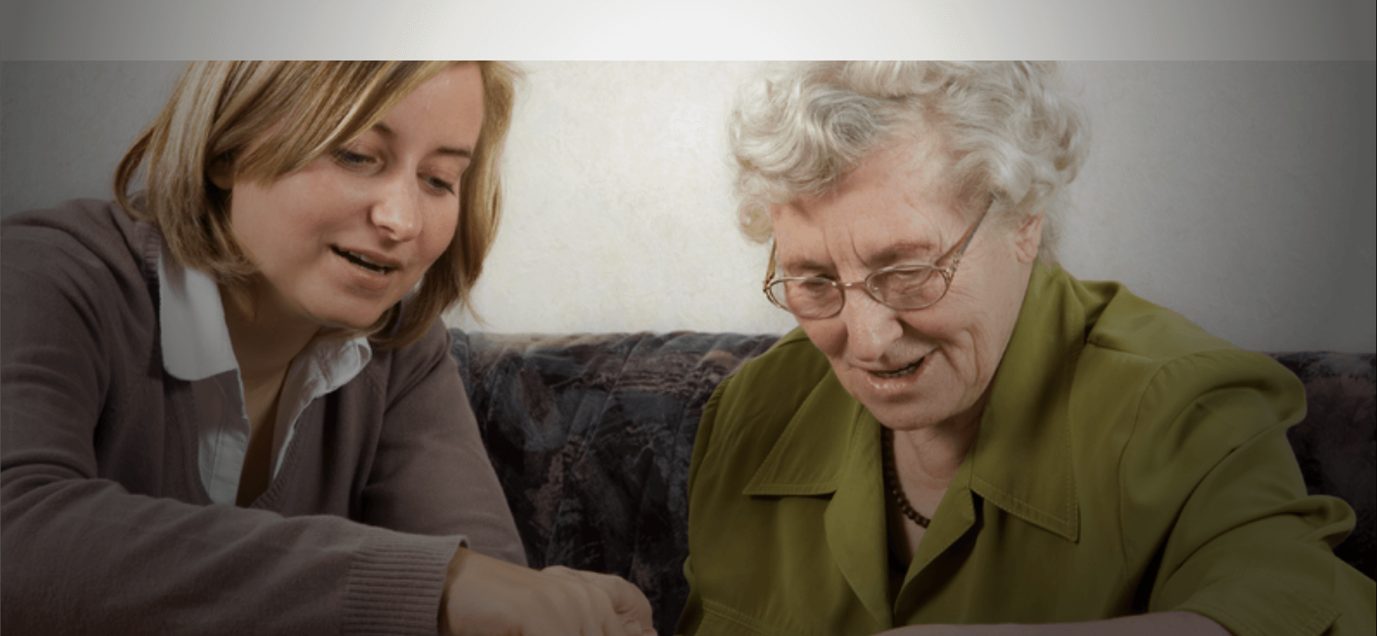 a lady and an old woman playing ludo