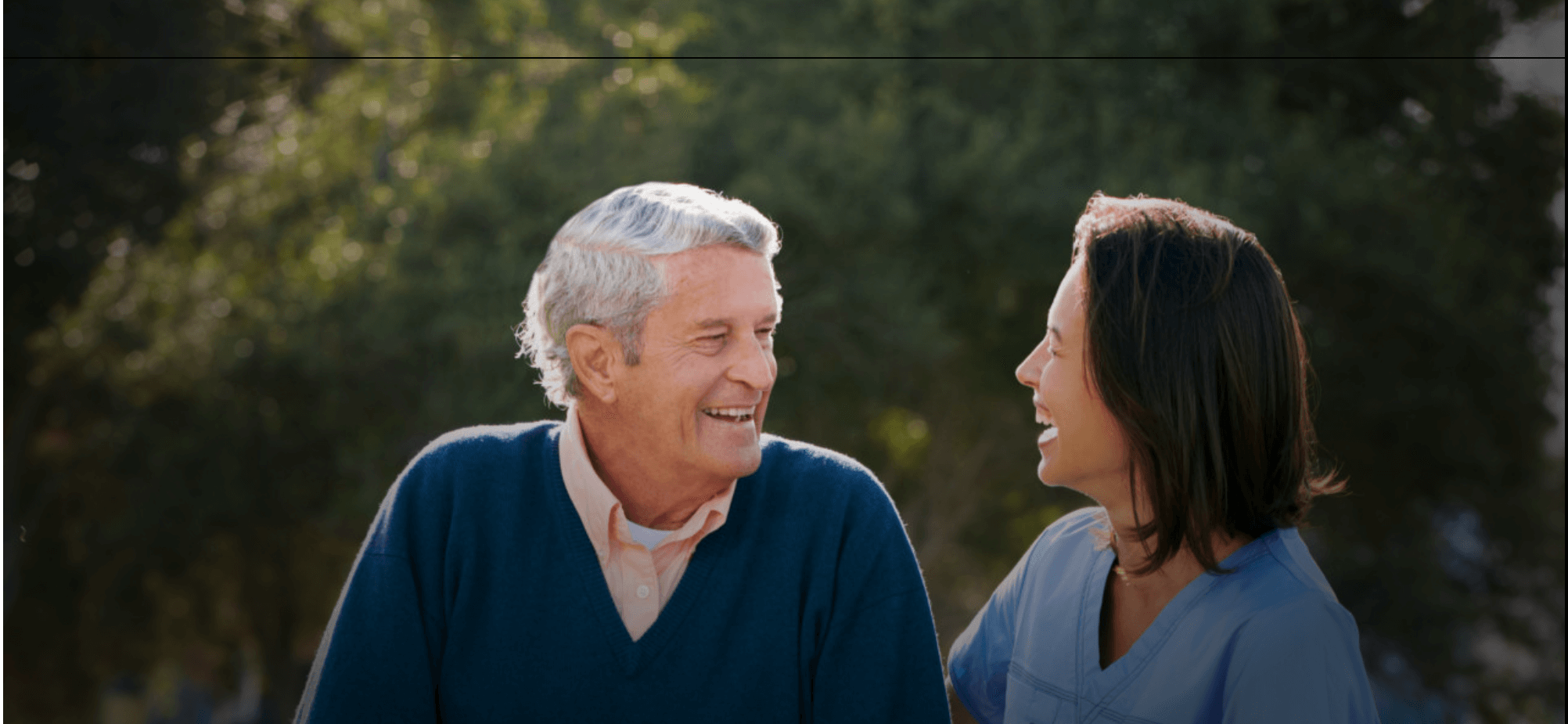 a nurse and an old man smiling