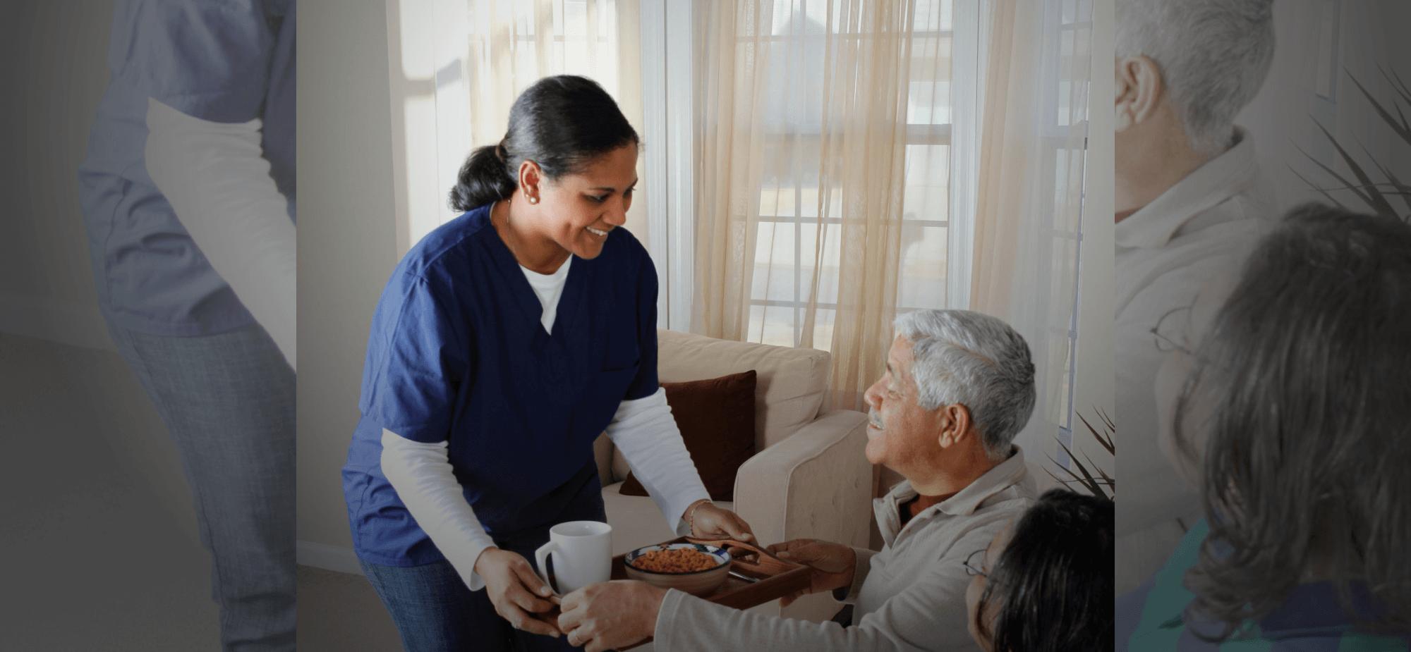 a nurse serving an old couple