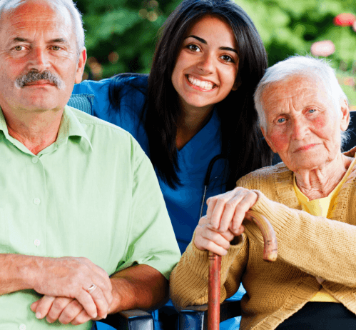 a nurse smiling with an old couple