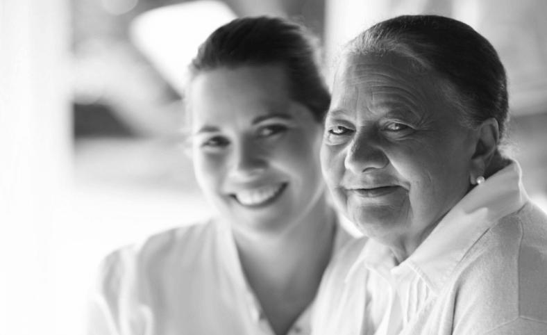 a nurse and a patient smiling