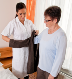 nurse assisting a patient to dress up