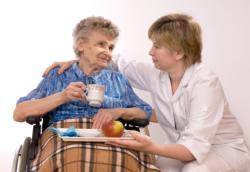 an nurse providing meal to an old woman