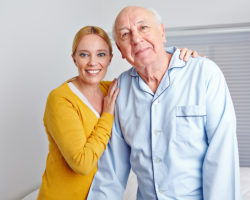 a lady and an old man smiling