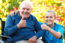 caregiver and patient doing OK sign